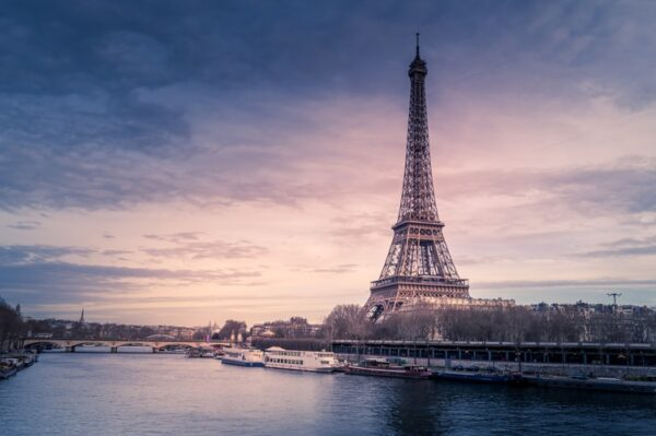 Eiffel tower during sunset with river in foreground
